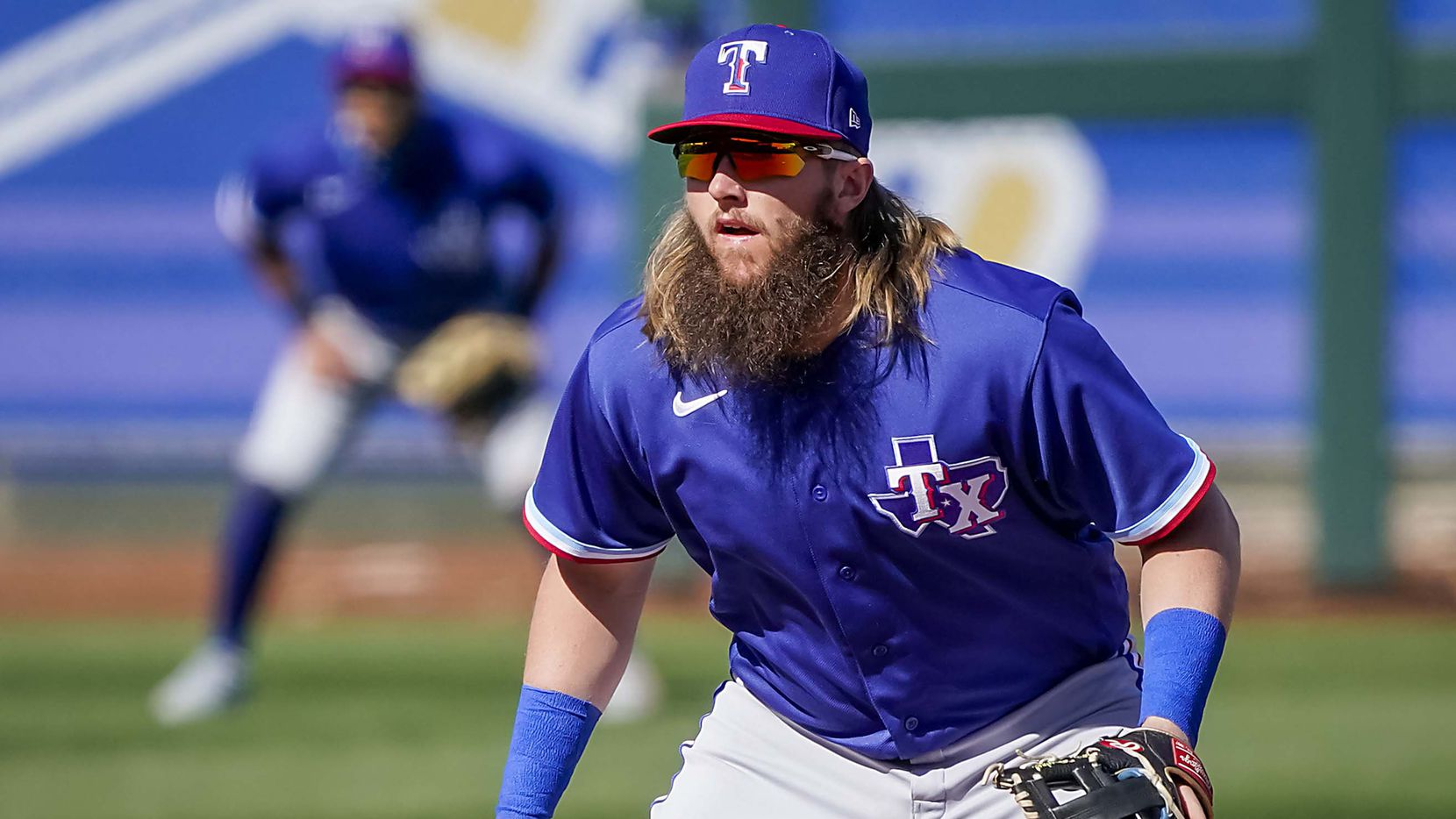 Rangers prospect Davis Wendzel fields at shortstop during the fifth inning of a spring training game against the Royals at Surprise Stadium on Sunday, Feb. 28, 2021, in Surprise, Ariz.