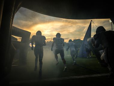 Frisco Lone Star</bold> cornerback Sherman Steptoe (16), offensive lineman Braden Grove (55) and wide receiver Marvin Mims (18) take the field to face Highland Park in a high school football game as the sun sets on Highlander Stadium in University Park.