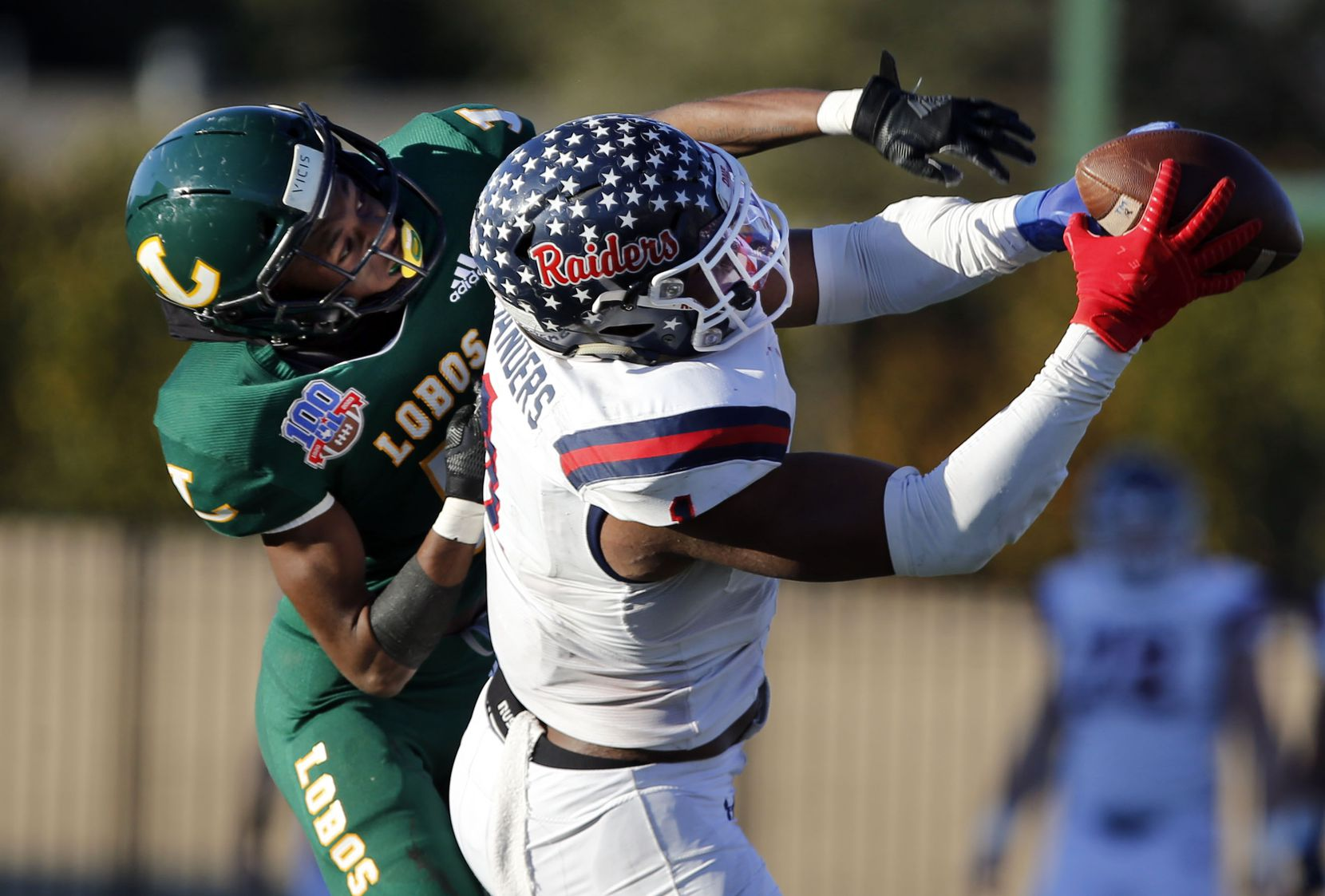 Denton Ryan's Ja'Tavion Sanders (1) catches a pass for a first down over Longview defender Dylan Davis (5) during the second half of a Class 5A Division I Region I semifinal football playoff game at Mesquite Memorial  Stadium in Mesquite on Saturday, December 26, 2020. (John F. Rhodes / Special Contributor)