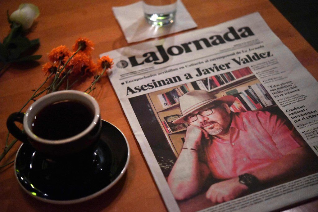 A makeshift altar with a cup of coffee and a newspaper headlining the story of slain Mexican journalist Javier Valdez in a cafe that he often frequented in Culiacán, Mexico.