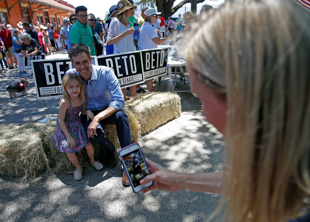 Chrissy Kleberg takes pictures of  her daughter Kathrine, 5, and U.S. Rep. Beto O'Rourke, D-El Paso, during a town hall at the Historic Santa Fe Train Depot in Gainesville.