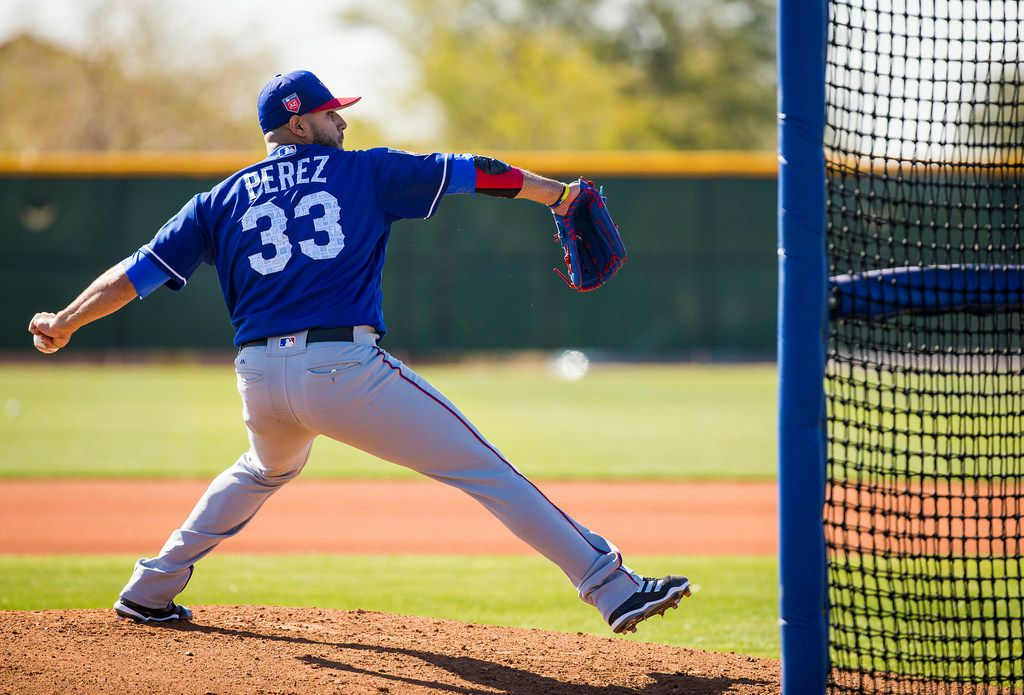 Texas Rangers pitcher Martin Perez throws live batting practice during a spring training workout at the team's training facility on Tuesday, Feb. 27, 2018, in Surprise, Ariz. (Smiley N. Pool/The Dallas Morning News)