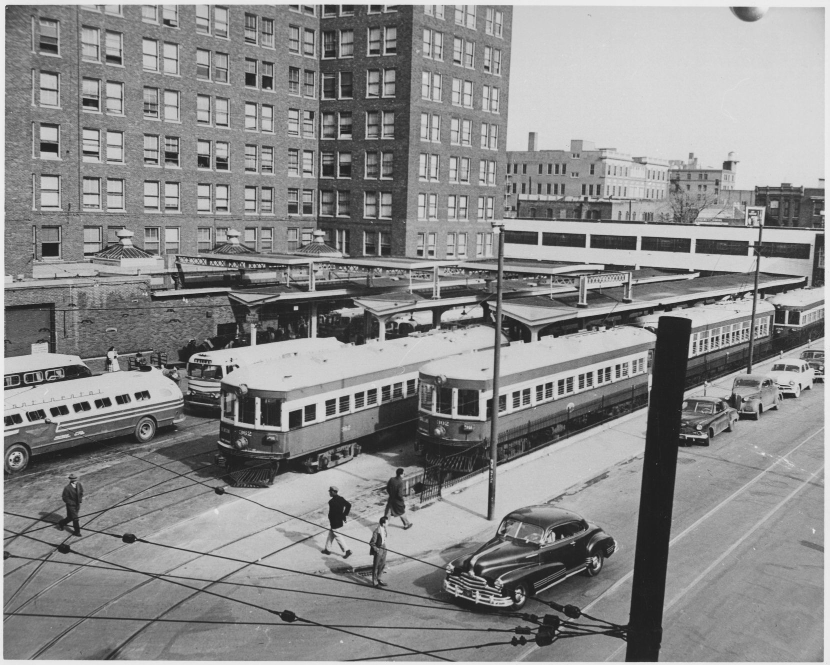 Electric trains line up outside downtown Dallas' Interurban Building in the 1940s.