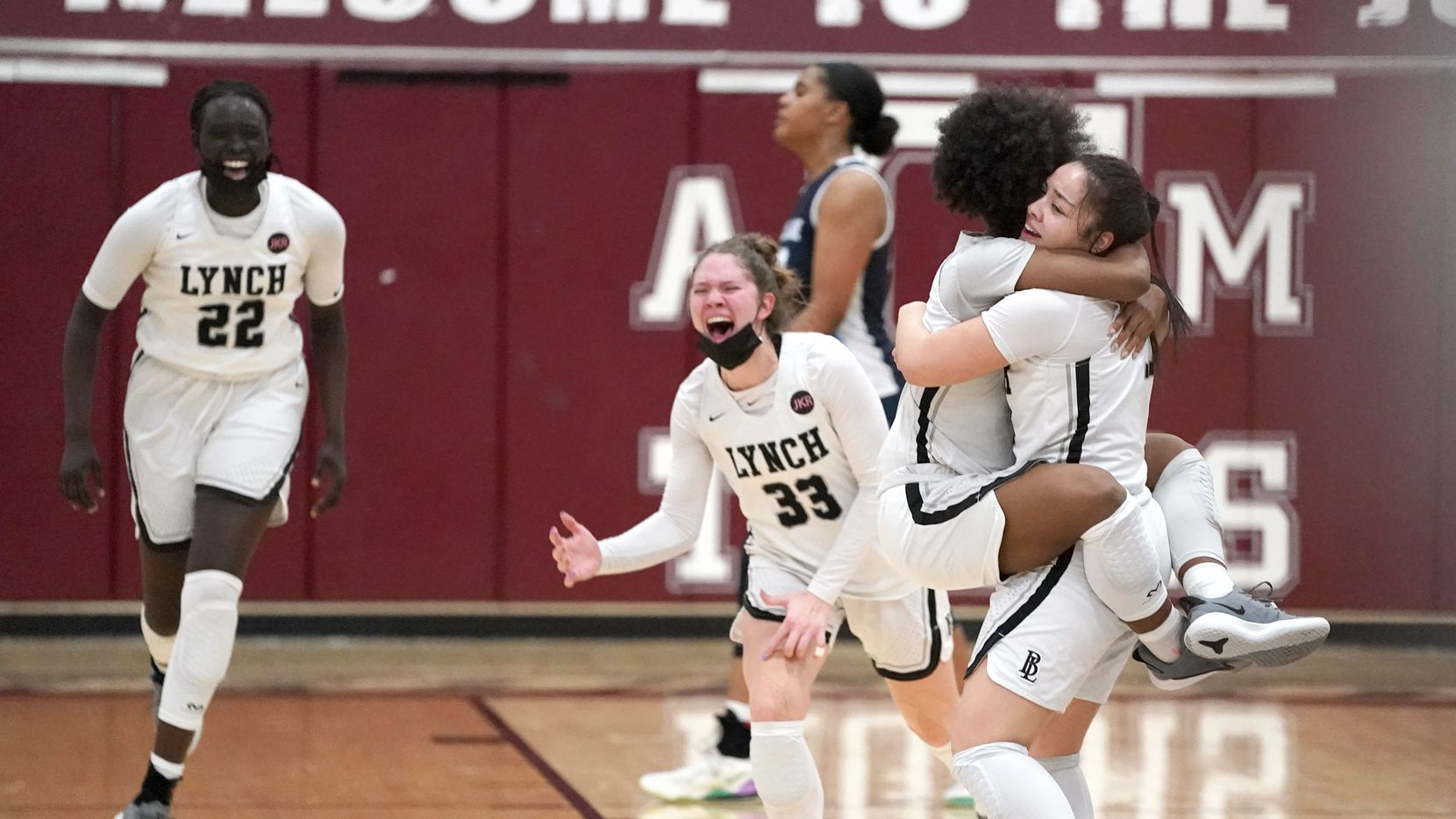 Dallas Bishop Lynch's Madison Cockrell (5) jumps into the arms of Talia Depetrillo (11) after defeating The Village School in the TAPPS 6A girls basketball championship game at A&M Consolidated High School in College Station, Texas on Friday, March 12, 2021.