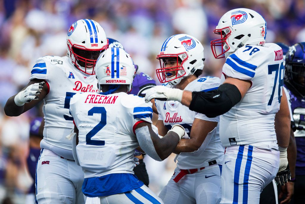 Southern Methodist Mustangs players celebrate a touchdown by Southern Methodist Mustangs running back Ke'Mon Freeman (2) during the second quarter of a college football game between SMU and TCU on Saturday, September 21, 2019 at Amon G. Carter Stadium in Fort Worth.
