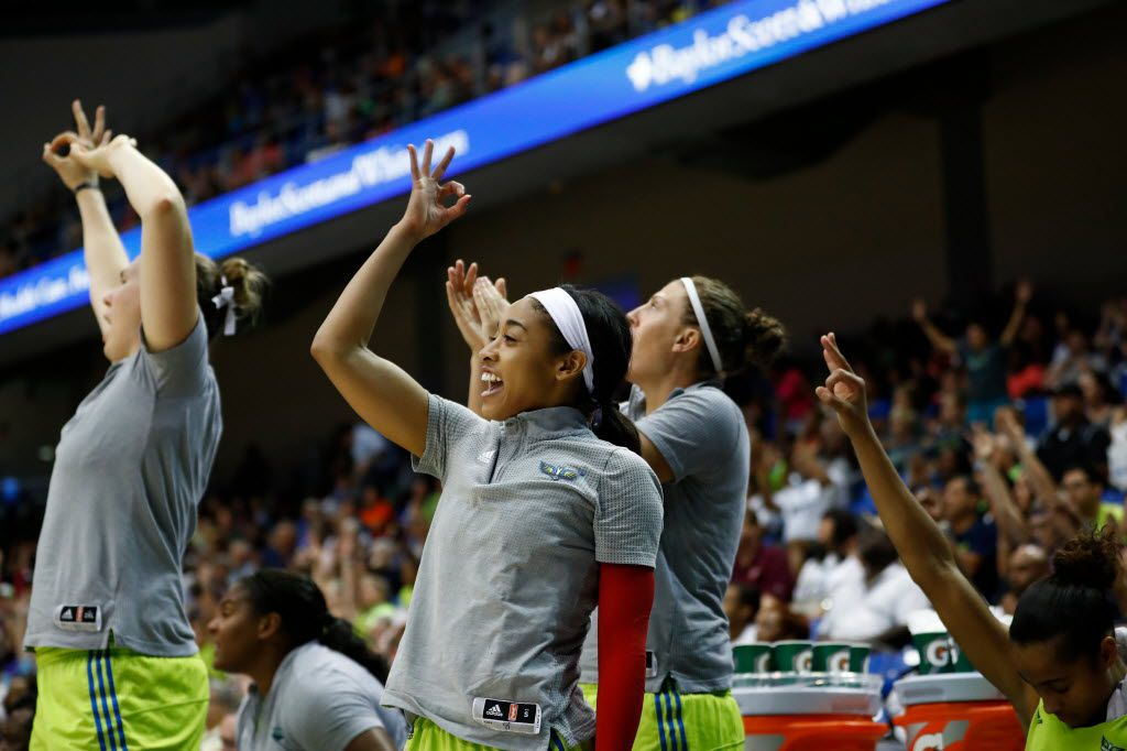Dallas Wings guard Tiffany Bias (8) celebrates on the sideline along with teammates during a WNBA basketball game between the Chicago Sky and the Dallas Wings at College Park Center on Aug. 28, 2016 in Arlington, Texas. (Ting Shen/The Dallas Morning News)