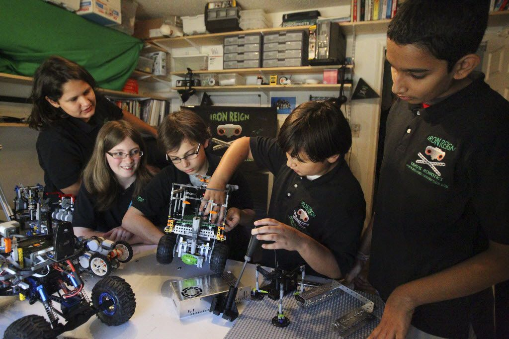Members of the Iron Reign robotics team from Dallas ISD's William B. Travis Vanguard and Academy showed off their creations several years ago. The work earned them a spot in an international robotics contest sponsored by Google and Lego.  Left to right were Max Virani, 13; Caitlin Rogers, 13; Ethan Helfman, 11; Tycho Virani, 11; and Jayesh Sharma, 13.