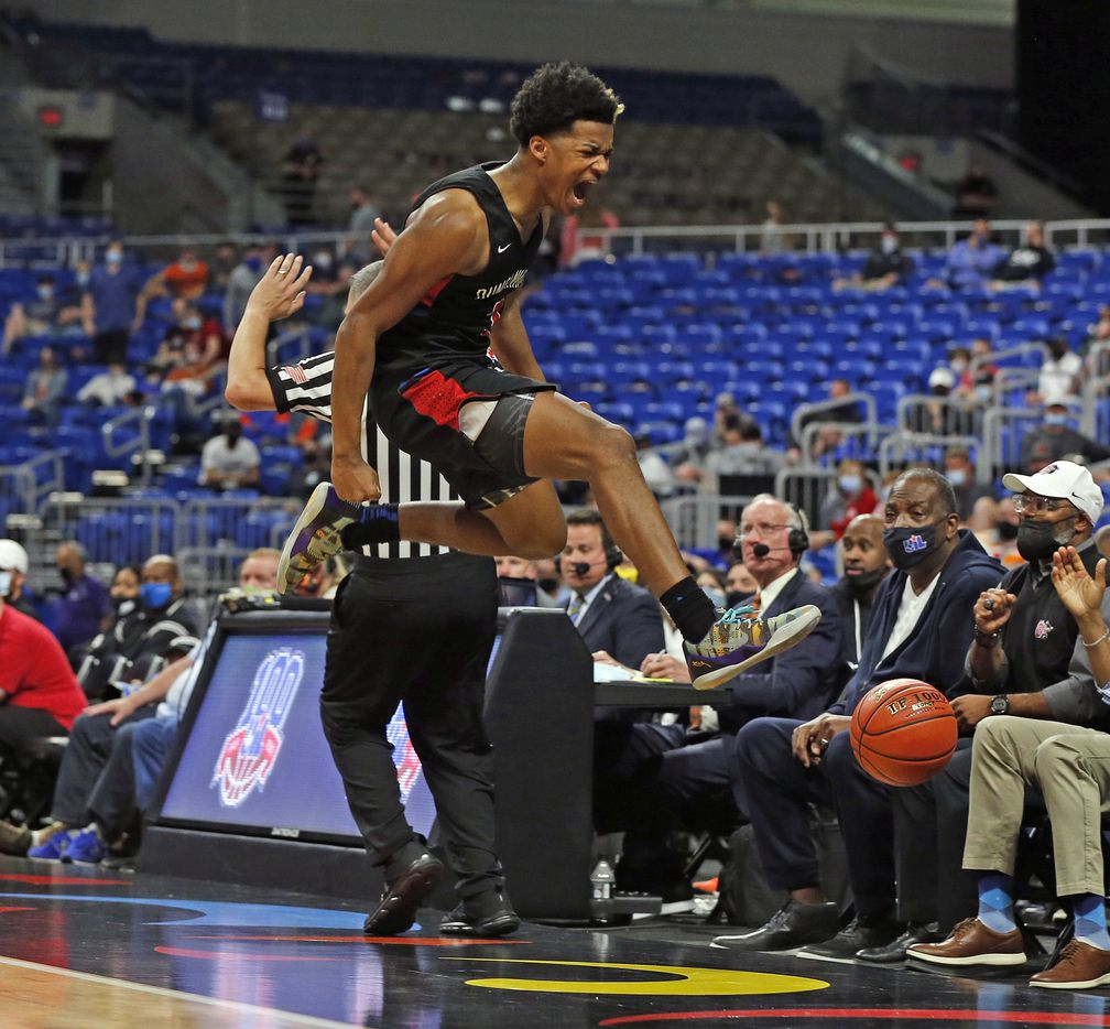 Duncanville CJ Ford #3 although could not save the ball from going out of bounds still celebrates in closing minute of play. UIL boys Class 6A basketball state championship game between Duncanville and Austin Westlake on Saturday, March 13, 2021 at the Alamodome.