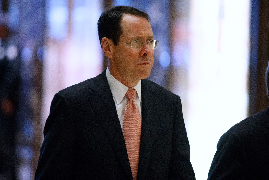AT&T CEO Randall Stephenson arrives in the lobby of Trump Tower in New York on Thursday morning for a meeting with President-elect Donald Trump. (AP/Evan Vucci)che