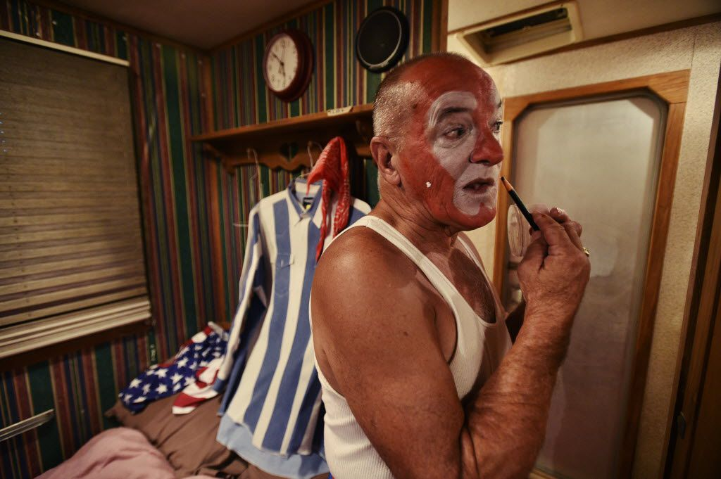 Rodeo clown Rudy Burns puts on his makeup in his trailer before a night in the barrel at the Miller Lite Bull Blowout rodeo event at the North Texas Fair and Rodeo, Thursday, August 27, 2015, in Denton, TX. David Minton/DRC