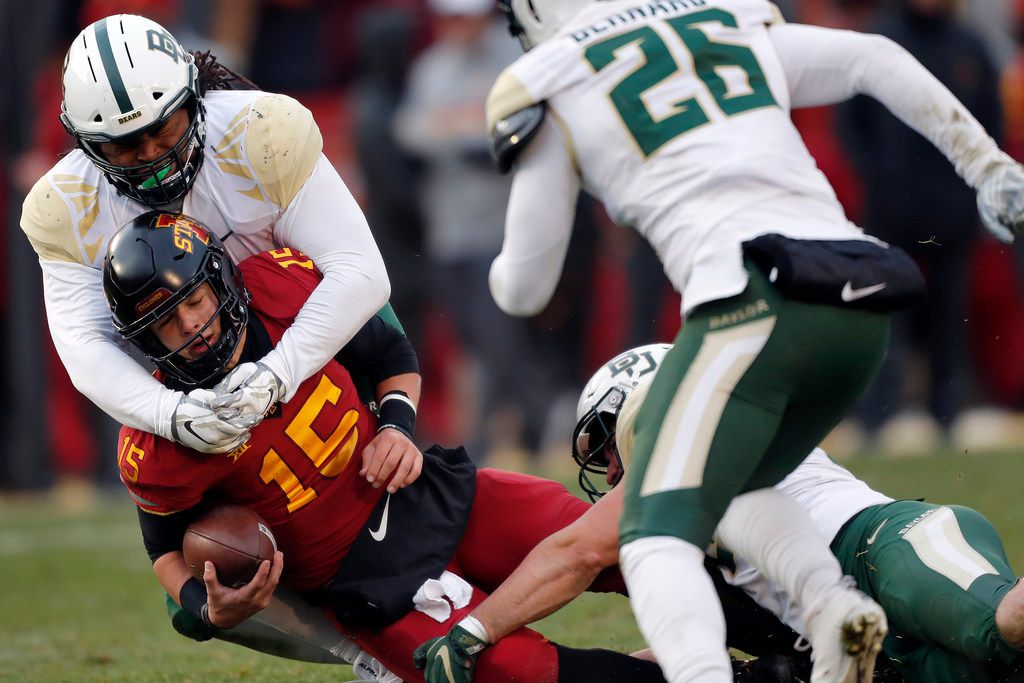 Iowa State quarterback Brock Purdy (15) is tackled by Baylor defensive tackle Bravvion Roy during the first half of an NCAA college football game, Saturday, Nov. 10, 2018, in Ames. (AP Photo/Matthew Putney)