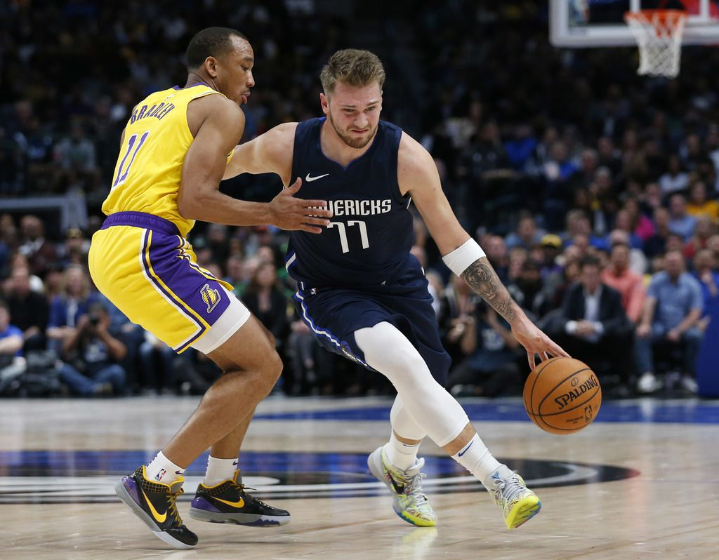 Dallas Mavericks guard Luka Doncic (77) drives on Los Angeles Lakers guard Avery Bradley (11) during the first quarter of play at American Airlines Center in Dallas on Friday, November 1, 2019.