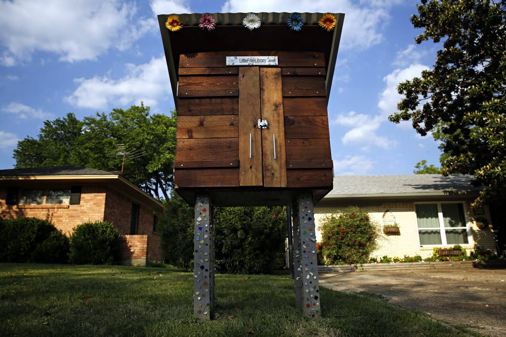 Stacy Holmes' Little Free Library in Lake Highlands, which sparked the city's attempt to write a rulebook.