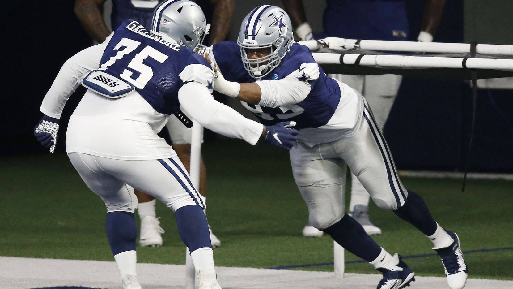 Dallas Cowboys defensive tackle Gerald McCoy (93) runs through a drill with Dallas Cowboys defensive tackle Neville Gallimore (75) during training camp at the Dallas Cowboys headquarters at The Star in Frisco, Texas on Monday, August 17, 2020.