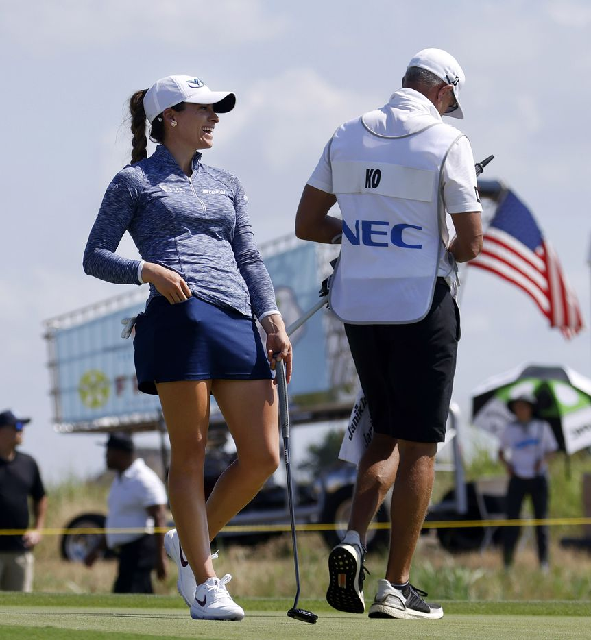 Professional golfer Gaby Lopez laughs with Jin Young Ko's caddie as she waits to putt on No. 18 No. 1 during the opening round of the LPGA VOA Classic at the Old American Golf Club in The Colony, Texas, Thursday, July 1, 2021. (Tom Fox/The Dallas Morning News)
