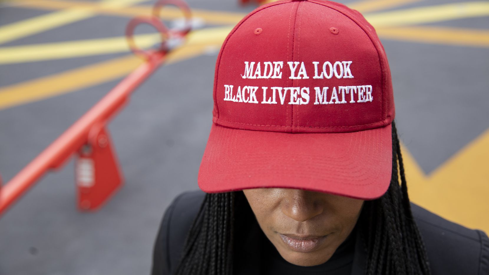 "Shenita Cleveland wears her 'Made ya look Black lives matter"" hat at Pacific Plaza in Dallas on Thursday, Jan. 7, 2021. Cleveland, 48, was shot with less than lethal rounds and arrested for breaking the city's curfew after attending a George Floyd protest on Sunday, May 31. (Juan Figueroa/ The Dallas Morning News)"
