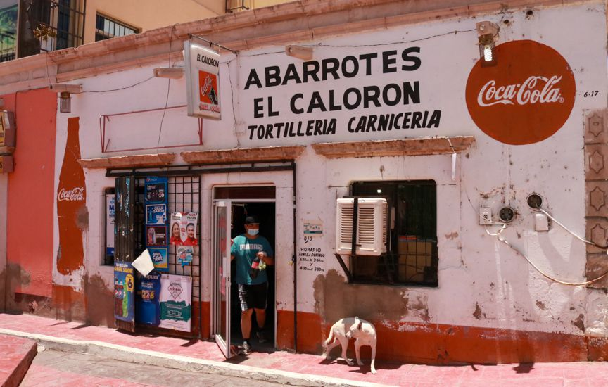 El Calorón, a corner convenience store on the main street. The store is run by Elizabeth García and her aunt Clara García. The store also sells fresh-baked tortillas, homemade chile colorado and new handbags and shoes brought from the U.S.
