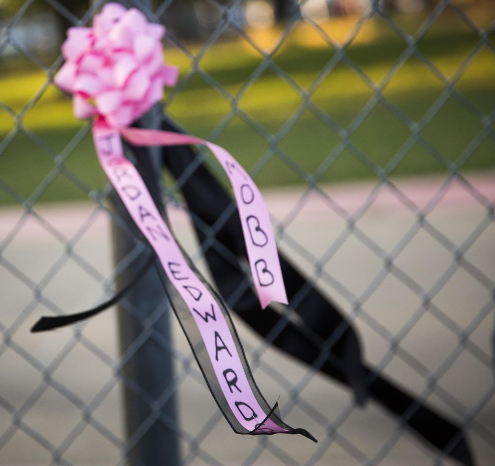 """A ribbon bearing his name flutters from a fence during the """"Remember His Name: Vigil for Jordan Edwards"""" candlelight vigil at Virgil T. Irwin Park on Thursday, May 4, 2017, in Balch Springs, Texas."""