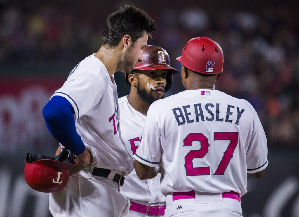 Texas Rangers third baseman Joey Gallo (13) and left fielder Delino DeShields (3) talk to third base coach Tony Beasley (27) during the seventh inning of an MLB game between the Texas Rangers and the Oakland Athletics on Saturday, May 13, 2017 at Globe Life Stadium in Arlington, Texas. (Ashley Landis/The Dallas Morning News)