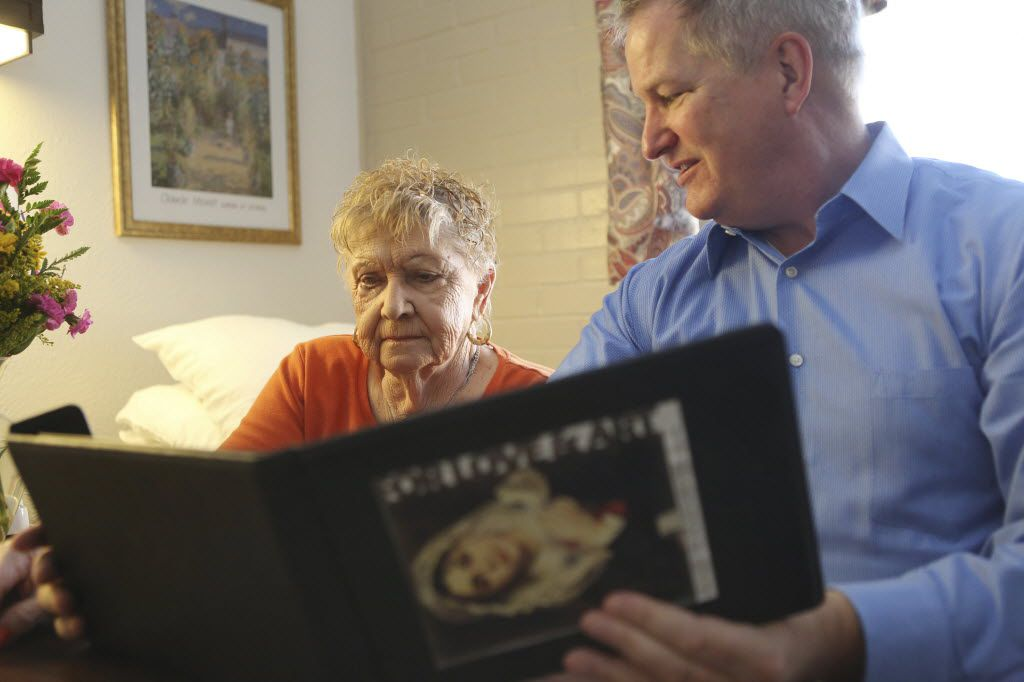 At a nursing home in Irving in 2012, a volunteer showed a digital art book to a resident. It was part of a program bringing art to those who can't go to museums.