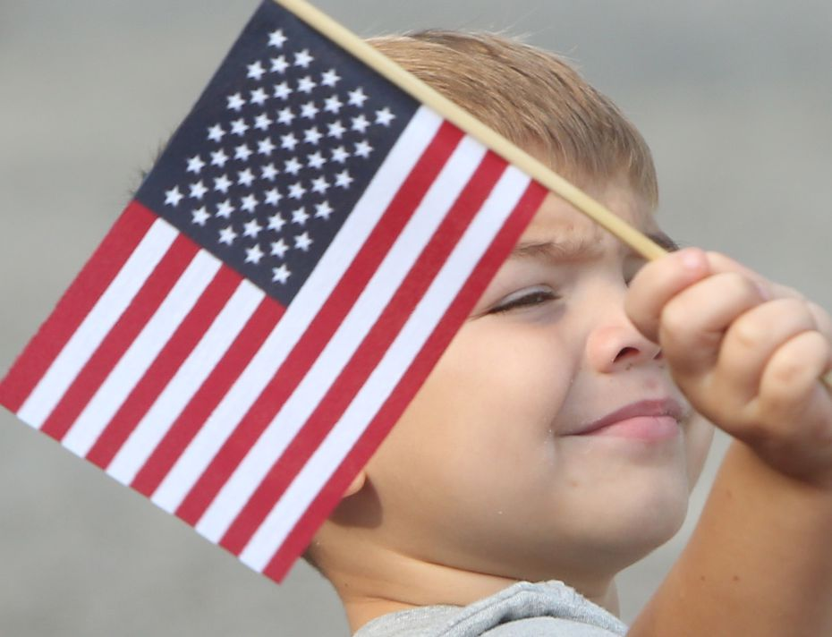 Alex Medina, 3, of Mansfield, waves an American flag at the 52nd annual 4th of July Parade in Arlington. (Steve Hamm/Special Contributor)