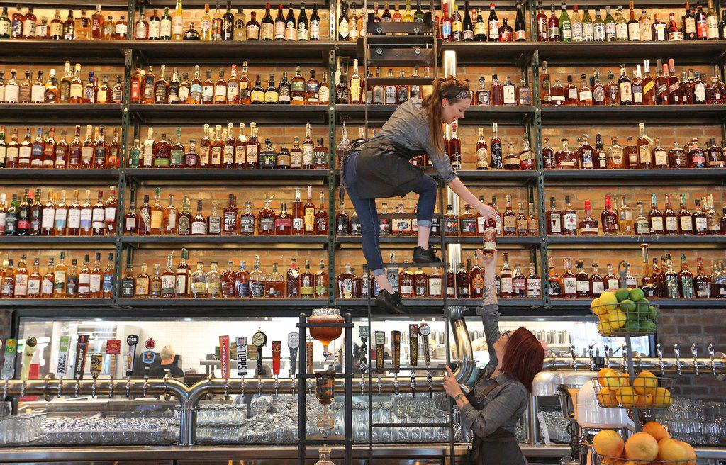 A look at the display of whiskeys available at Whiskey Cake restaurant and bar on Regent Boulevard in Irving, Texas, photographed on Wednesday, May 30, 2018. (Louis DeLuca/The Dallas Morning News)