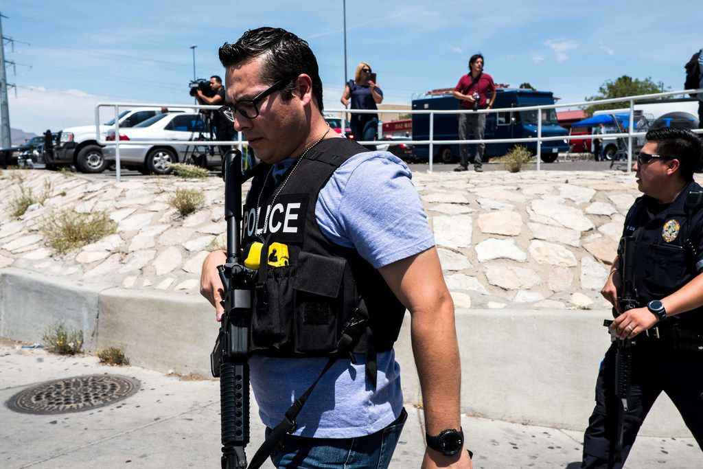 """Law enforcement agencies respond to an active shooter at a Wal-Mart near Cielo Vista Mall in El Paso, Texas, Saturday, Aug. 3, 2019. - Police said there may be more than one suspect involved in an active shooter situation Saturday in El Paso, Texas. City police said on Twitter they had received """"multi reports of multipe shooters."""" There was no immediate word on casualties. (Photo by Joel Angel Juarez / AFP)JOEL ANGEL JUAREZ/AFP/Getty Images"""