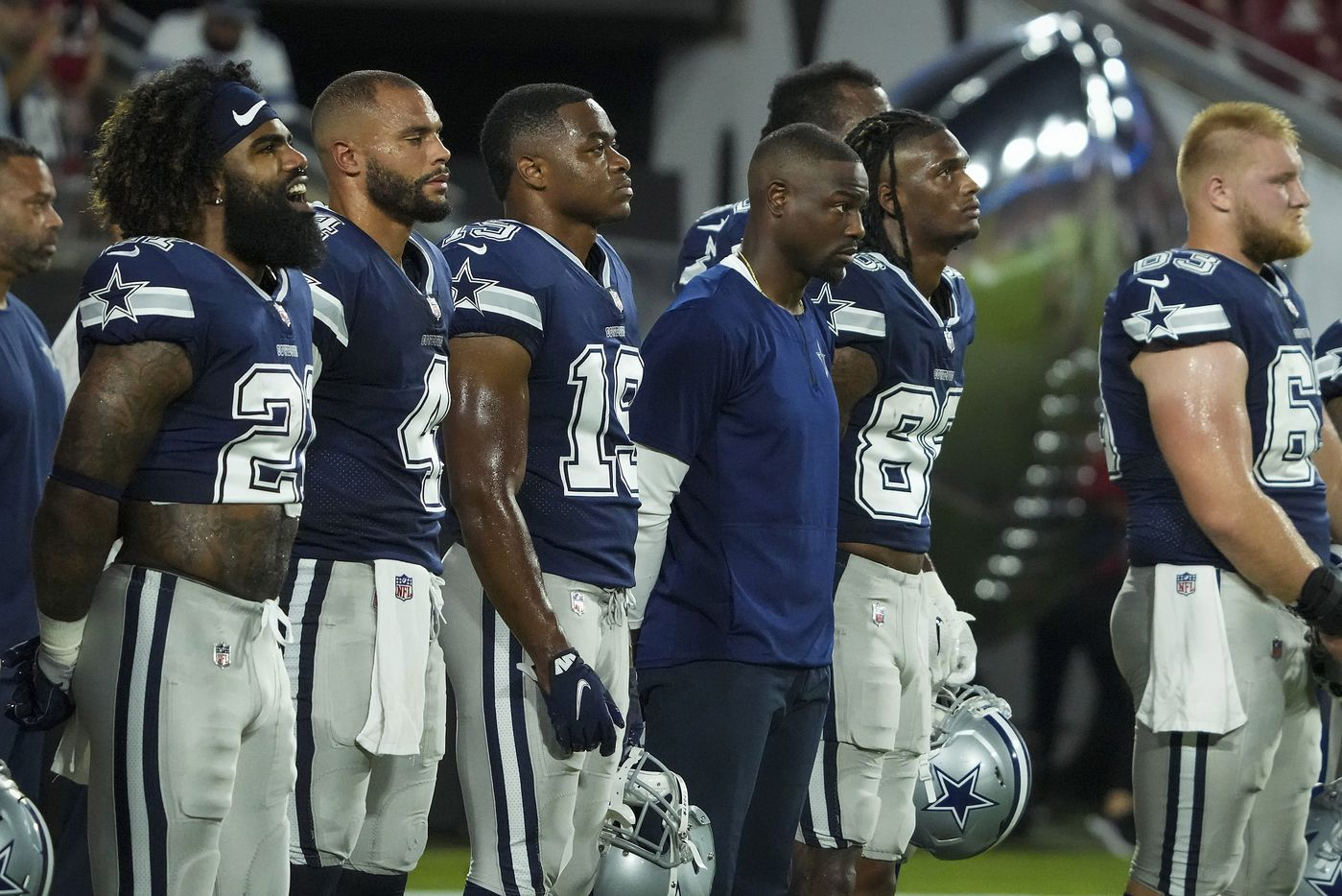 """Dallas Cowboys running back Ezekiel Elliott (21) sings along with the playing of """"Lift Every Voice and Sing"""" before an NFL football game against the Tampa Bay Buccaneers at Raymond James Stadium on Thursday, Sept. 9, 2021, in Tampa, Fla. (Smiley N. Pool/The Dallas Morning News)"""