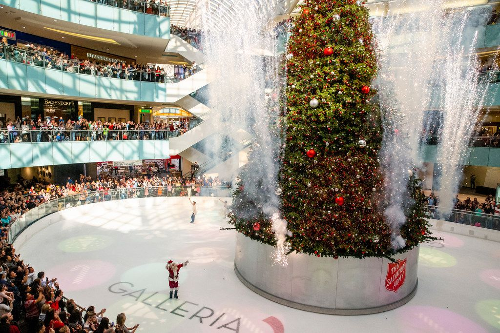 Missile Toes, the skating Santa,  waves to the crowd as the  Christmas tree is lit at Galleria Dallas.