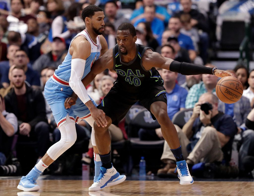 Sacramento Kings guard Garrett Temple, left, defends as Dallas Mavericks forward Harrison Barnes (40) works for a shot opportunity in the first half of an NBA basketball game Tuesday, Feb. 13, 2018, in Dallas. (AP Photo/Tony Gutierrez)