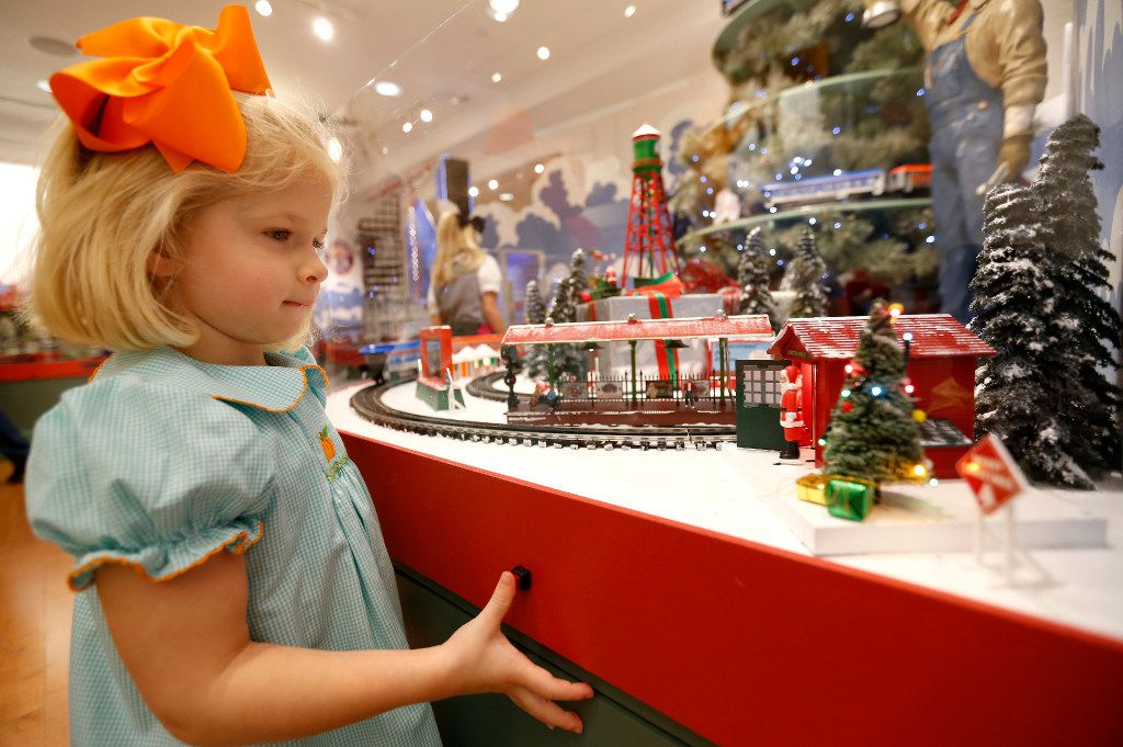 "Neely Cordon, 3, looks at a miniature display at an exhibit of ""The Trains at NorthPark Center"" benefiting the Ronald McDonald House of Dallas at NorthPark Center in Dallas, Friday, Nov. 18, 2016. The elaborate miniature toy trains exhibit features more than 750 railcars on a 1,600-foot intricate configuration of tracks set and a special tribute to the Dallas Police Department this year."
