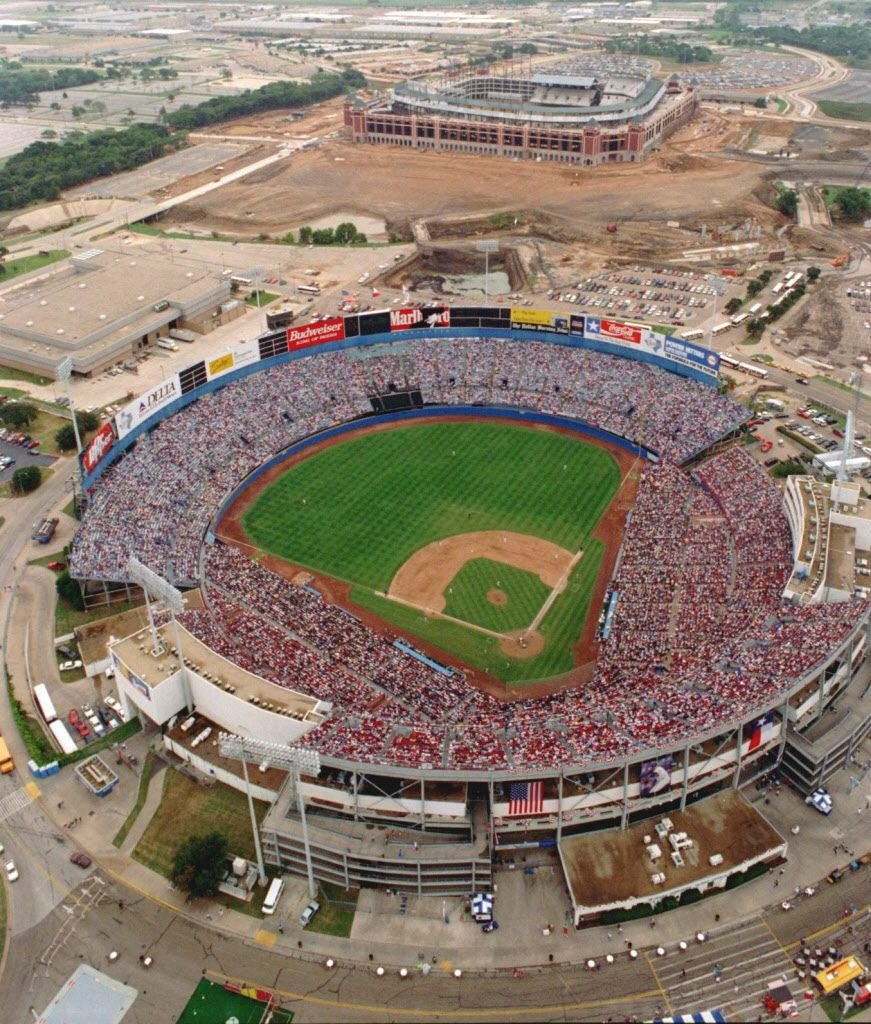 A sellout crowd watches the final game in Arlington Stadium. Globe Life Park, then known as The Ballpark in Arlington, is in the distance.