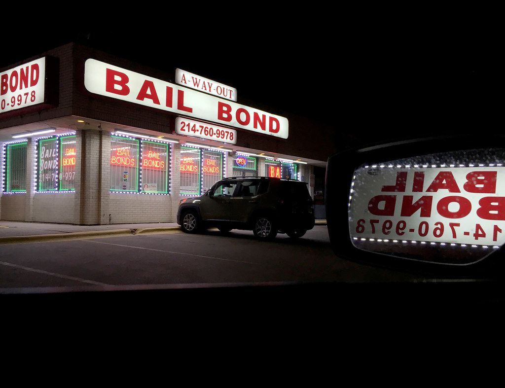 Lights from a bail bond business glow in the darkness along Riverfront Blvd. in Dallas, on Sunday night, Jan. 21, 2018. Three nonprofits filed a federal civil rights lawsuit alleging the Dallas County jailís cash bail system unfairly harms poor people and violates the Texas and U.S. constitutions. The lawsuit alleges Dallas Countyís cash bail system fails to consider a jailed defendantís ability to pay, resulting in disparate treatment in the criminal justice system. Poorer citizens remain jailed for weeks ó even months ó because they canít afford to pay their way out, while wealthier people can quickly purchase their freedom, states the lawsuit, filed on behalf of six Dallas County jail inmates. (Michael Hamtil/The Dallas Morning News)