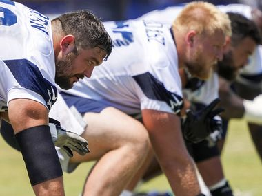 Dallas Cowboys guard Zack Martin (left) lines up beside center Tyler Biadasz, guard Connor Williams and tackle Tyron Smith during a practice at training camp on Tuesday, July 27, 2021, in Oxnard, Calif.