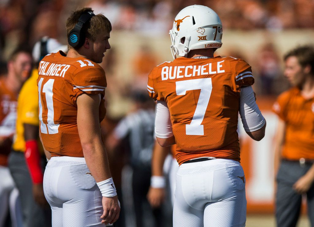 Texas quarterbacks Sam Ehlinger (11) and Shane Buechele (7) talk on the sideline during the second quarter of the Longhorns' 23-17 win over Baylor on Saturday, October 13, 2018 at Darrell K Royal Memorial Stadium in Austin, Texas. (Ashley Landis/The Dallas Morning News)