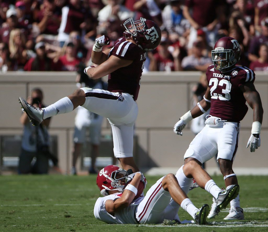 Texas A&M Aggies linebacker Richard Moore (7) celebrates after tackling Alabama Crimson Tide wide receiver Derek Kief (81) in the first quarter during an NCAA football game between Alabama and Texas A&M at Kyle Field in College Station, Texas Saturday October 17, 2015. Texas A&M Aggies lost to Alabama Crimson Tide 23-41. (Andy Jacobsohn/The Dallas Morning News)