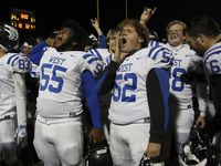 Plano West offensive linemen Jaylen Edwards (55) and Cortland Barnett (52) let out a yell as the Wolves celebrated with the student section following their 31-24 come-from-behind victory over Plano to earn a playoff berth. The two teams played their District 6-6A football game at Clark Stadium in Plano on December 4, 2020.