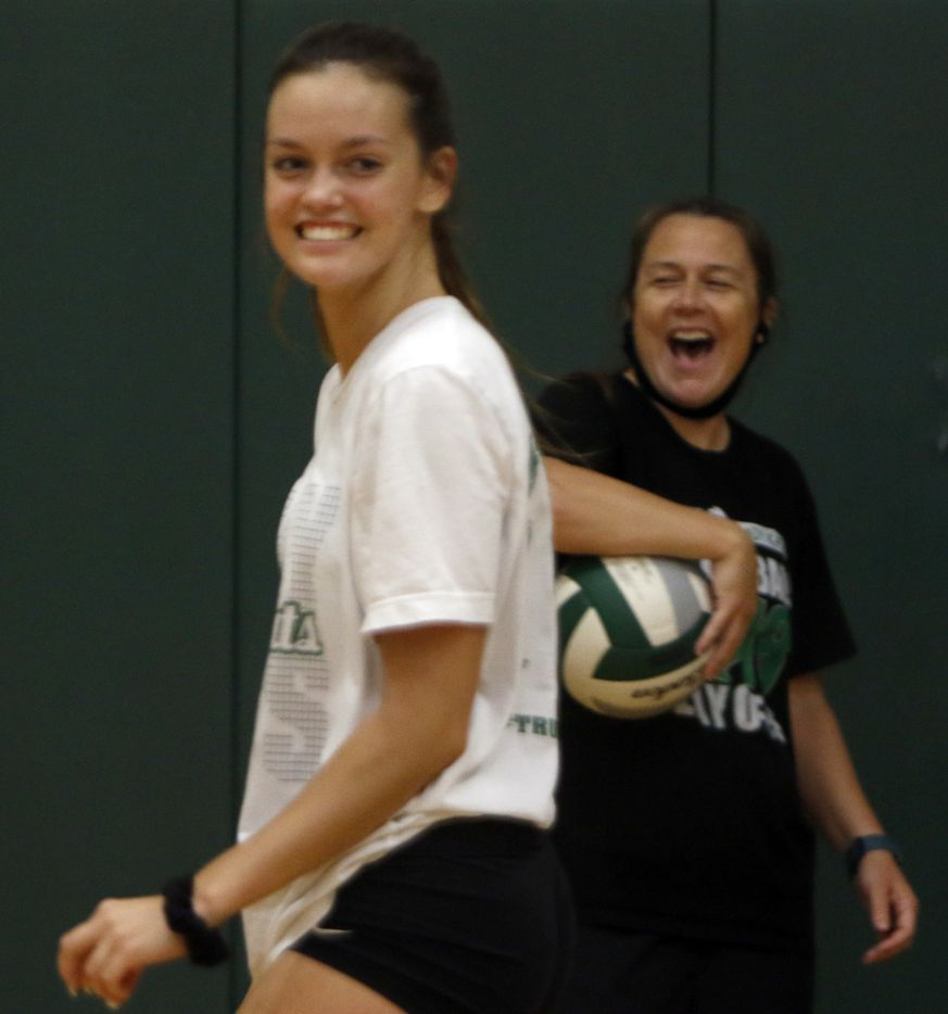 Kennedale head volleyball coach Kelly Carl, right, delights after outside hitter Bryley Steinhilber scores during a practice session. Under the direction of Carl, the team conducted their first practice of the season at Kennedale High School in Kennedale on August 03, 2020.(Steve Hamm/ Special Contributor)