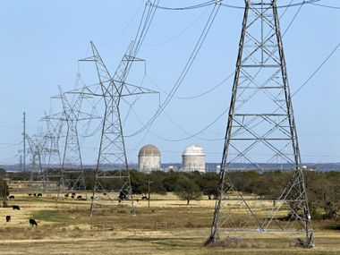 Electrical transmission lines lead to the Comanche Peak Nuclear Power Plant near Glen Rose on March 23, 2011. Reactor Units 1, right, and 2 can be seen at the plant.