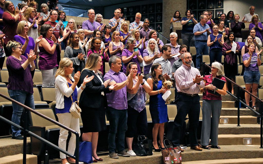 Most of the public in attendance stood in applause after hearing The Turning Point executive director Wendy Hanna speak as during a Plano City Council work session Saturday, Aug. 17, 2019.