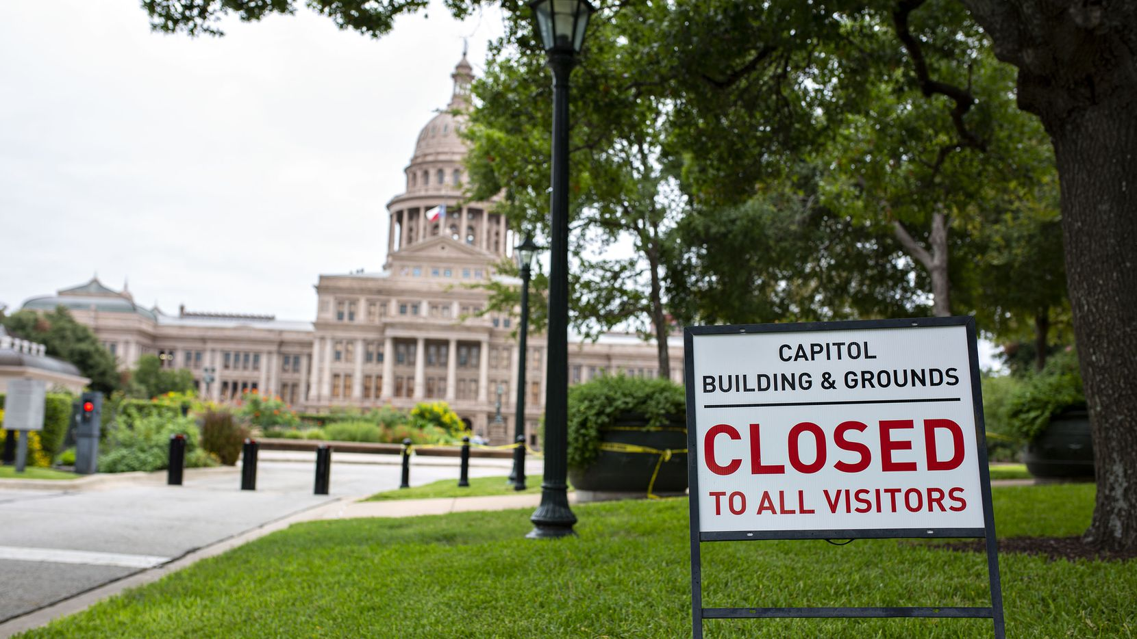 Yellow police tape and closed signs dot the grounds of the Texas Capitol in Austin, as it remained closed to visitors on Sept. 24, 2020 -- 110 days before the start of the Legislature's 87th regular session on Jan. 12, 2021.