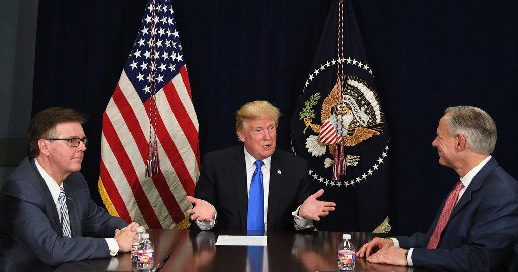 President Donald Trump met with Lt. Gov. Dan Patrick and Gov. Greg Abbott in Dallas for a briefing on hurricane relief efforts. (Jim Watson/Agence France-Presse)