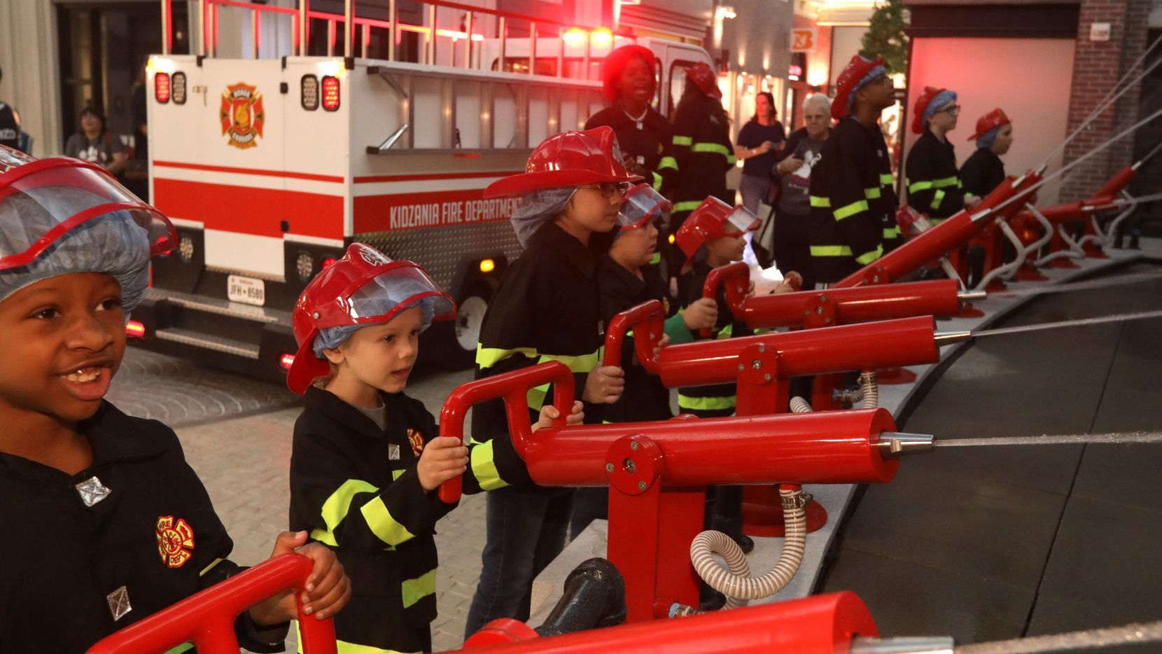 Children fight a fire at Stonebriar Centre's KidZania, an educational entertainment venue for kids.