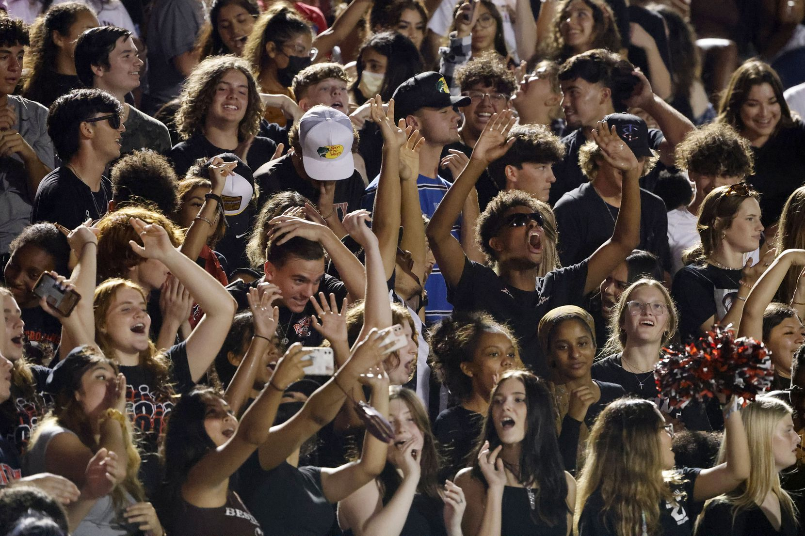 The Euless Trinity student section cheers during the first half of their high school football game against Arlington Lamar, in Bedford, Texas on Aug. 26, 2021. (Michael Ainsworth/Special Contributor)