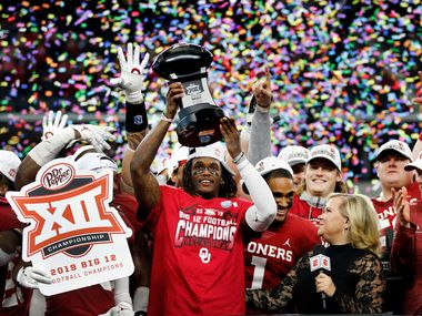 Oklahoma Sooners wide receiver CeeDee Lamb celebrates with the most outstanding player award and his teammates following their Big 12 Championship win over Baylor Bears at AT&T Stadium in Arlington, Saturday, December 7, 2019. Oklahoma won in overtime, 30-23.