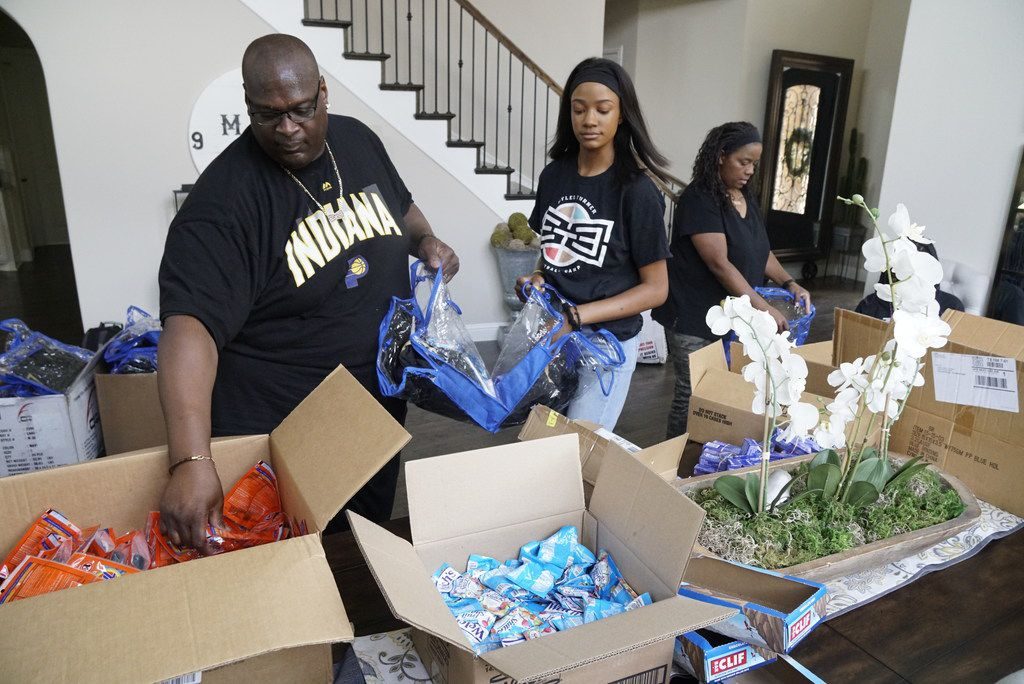 Indiana Pacers Center Myles Turner's parents Mary & David Turner and sister Mya Turner puts care packages together for the homeless at their home in Colleyville, Texas on Wednesday, June 26, 2019.  (Lawrence Jenkins/Special Contributor)