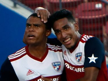 FC Dallas defenseman Reggie Cannon (2), left, is congratulated by teammate Jesus Ferreira (27) following Cannon's tie splitting goal late in the first half of play against Minnesota United FC. The two MLS teams competed in their match which was held at Toyota Stadium in Frisco on August 10, 2019.