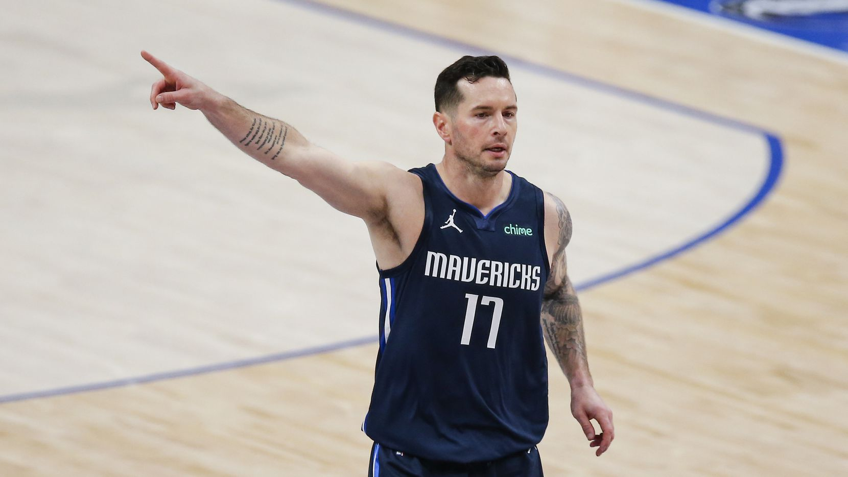 Dallas Mavericks guard JJ Redick (17) directs his teammates during the first half of an NBA basketball game against the Philadelphia 76ers in Dallas, Monday, April 12, 2021.
