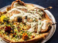 The El Relleno pizza at Nico's MX Pizzeria and Cocktail Venue in Dallas comes with three chile rellenos on top.