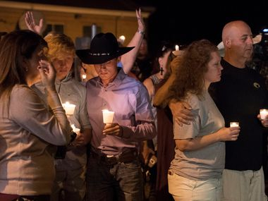 Mourners participate in a candlelight vigil held for the victims of a fatal shooting at the First Baptist Church of Sutherland Springs, Sunday, Nov. 5, 2017, in Sutherland Springs, Texas.